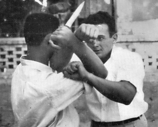 Moshe Feldenkrais demonstrating knife defense